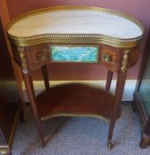 A French Style Kidney Shaped Lounge Table, 20th century, Having a gallery rail above a single drawer
