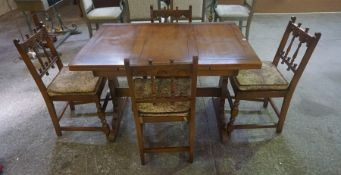 An Ercol Pull Out Dining Table with Four Chairs, Table 75cm high, 115cm long, 80cm wide, the table