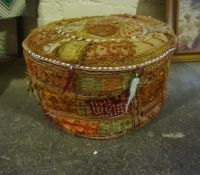 A Middle Eastern Pouffe, 29cm high, 51cm wide