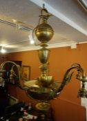 A Neo Classical Style Brass Ceiling Light, 20th century, Having five sconces, 94cm high, matches