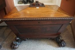 A Regency Mahogany Wine Cooler, circa early 19th century, Of sarcophagus form, Having a hinged top