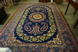 A Large Persian Carpet, Decorated with floral medallions and motifs on a blue ground, 375cm x 256cm
