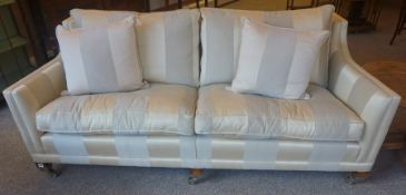 A Large Duresta Two Seater Sofa, In striped upholstery, raised on wooden feet with metal mounts
