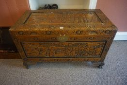 A Chinese Style Carved Camphorwood Blanket Chest, Decorated with carved panels of figures, lock