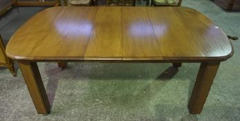 A Mahogany Extending Dining Table, circa early 20th century, Having two additional leaves, raised on