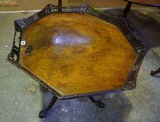 A George III Mahogany Tea Table, circa early 19th century, Having a trellis tray octagonal snap
