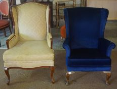 A Vintage Wing Armchair, Upholstered in blue velour, 97cm high, also with another armchair, 105cm