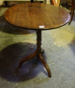 A George III Mahogany Tea Table, Having a circular snap action top, raised on a turned column and