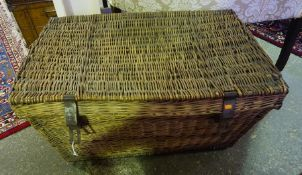 A Large Wicker Laundry Basket, 45cm high, 88cm wide, also with a Victorian tin travel trunk, with