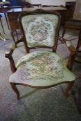 A French Style Elbow Chair, 20th century, Upholstered in floral fabric, 88cm high