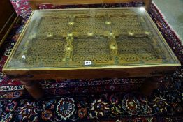 An Indonesian Hardwood Coffee Table, Having a paste shutter interior, 37cm high, 90cm wide