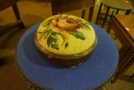 A Victorian Walnut Circular Footstool, Having a needlepoint top, 33cm diameter