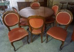 An Italian Style Pedestal Dining Table with Six Chairs, The table having a circular top, the