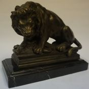A Bronzed Cast Iron Figure Group of a Lion with its Prey (Wild Boar), circa early late 19th /