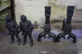 Two Pairs of Victorian Cast Iron Fire Dogs, One set modelled as an Admiral, 37cm, 45cm high, (4)