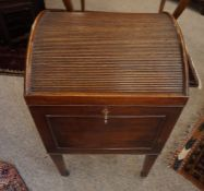A George III Style Mahogany Wine Cooler, circa 19th century, Having a hinged tambour shutter top,