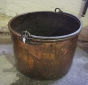 A Large Copper Cauldron, circa 19th century, Of cylindrical form, Having an iron handle, 63cm
