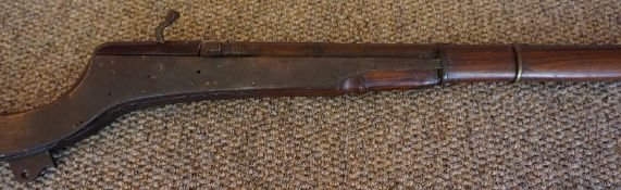 An Indian Muzzle Loading Matchlock Gun, circa 19th century, Having brass mounts, oak butt and stock,