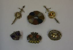 Six Assorted Scottish Brooches, To include a silver Iona style brooch, a silver brooch, and a pebble