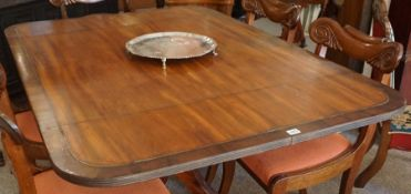 A Mahogany Supper Table, circa early 19th century, The snap action top having canted corners,