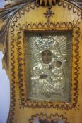 A Russian Icon, Depicting portrait masks on a silvered backing, inscribed to base, (Pod Twojh