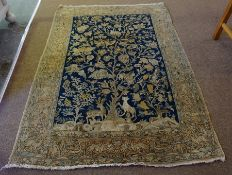 An Isfahan Rug (Central Iran), Decorated with panels of animals in foliage, on a blue ground,