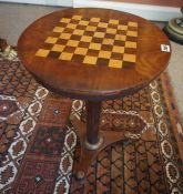 A Victorian Mahogany Occasional / Games Table, Having a satinwood and rosewood draughts surface to
