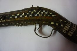 An Indian Percussion Musket, circa 19th century, The butt and stock decorated with mother of