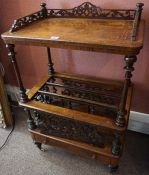 A Victorian Walnut Inlaid Canterbury, Having a carved gallery, raised on turned pilasters, above two
