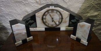 Art Deco French Three Piece Marble Clock Garniture, Comprising of mantel clock with a pair of side