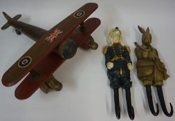 A Wooden Toy Model of a WWI Fighter Plane, 51cm long, also with a pair of carved wood hangers,