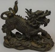 A Chinese Bronze Figure of a Dog of Foe, circa 19th century, 13cm high