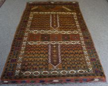 An Afghan Rug, Hand knotted, Decorated with allover multicoloured geometric motifs on a brown