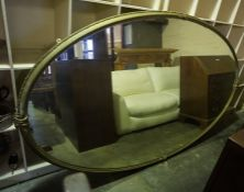 A Victorian Gilt Framed Wall Mirror, Of oval form, 244cm high, 140cm wide