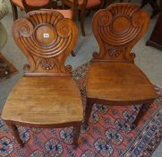 A Pair of Regency Mahogany Hall Chairs, circa early 19th century, Having triform shaped tops,
