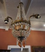 A French Crystal Chandelier, Having three gilt metal branches, Decorated with crystal and tinted
