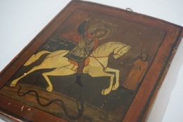 A Russian Icon on Wood Panel, circa 19th century, Depicting a painted figure on a horse, inscribed