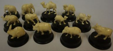 A Set of Twelve Carved Ivory Animal Place Settings, circa late 19th / early 20th century, Comprising