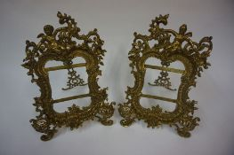 A Pair of French Gilt Metal Photo Frames, circa late 19th / early 20th century, Surmounted by a