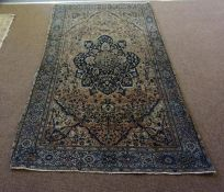 A Tabriz Rug (North West Persia), Decorated with a large floral medallion to the centre, with