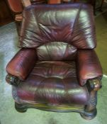 An Oak Framed Two Piece Leather Suite, Comprising of a two seater maroon leather sofa, with matching