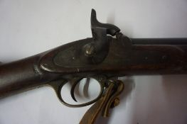 A Continental Percussion Musket, circa 19th century, Having a cap container mounted in the walnut