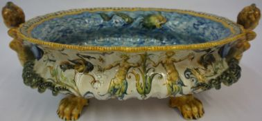 A Continental Majolica Fruit Bowl, circa 19th century, Decorated with dolphins to the interior,