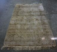 A Persian Rug, Decorated with geometric motifs, on a Caucasian style ground, faded to areas, 182cm x
