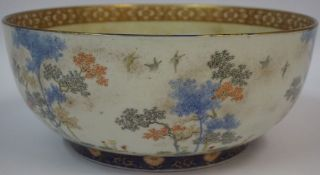 A Japanese Satsuma Bowl, Meiji Period, circa late 19th century, Decorated with woodland scenes, four