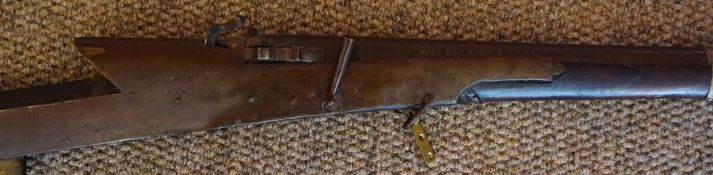 An Indian Muzzle Loading Matchlock Gun, circa 19th century, Signed to lock plate, Having a wooden
