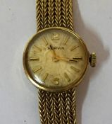 A 9ct Gold Ladies Swiss Made Wristwatch by Marvin, With baton numerals to the dial, on a gold mesh