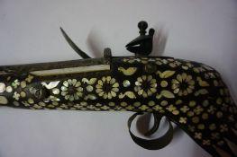 An Eastern Flintlock Long Gun, Probably of Indian Origin, circa early 19th century, Having ramrod,
