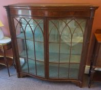 A Mahogany Inlaid Display Cabinet, 20th century, Having two glazed astragal doors enclosing a