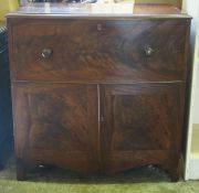 An Early Victorian Mahogany Commode, circa 1840, Modelled as a cupboard chest, Having a hinged top